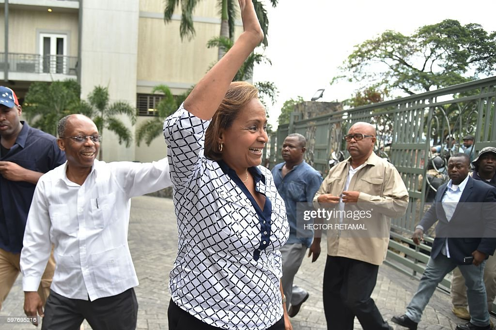 Presidential Candidate from Lavalas Political Party Marysse Narcisse with former President Jean Bertrand Aristide greet their supporters after giving...