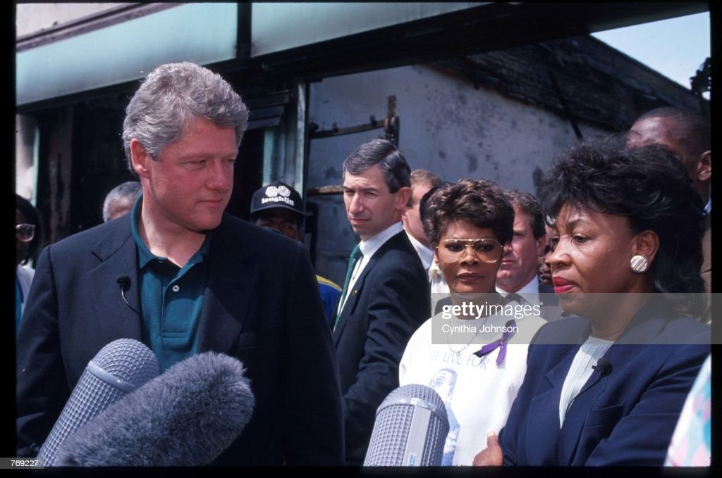 Presidential candidate Governor Bill Clinton (D-AR) stands with singer Dionne Warwick and US Representative Maxine Waters (D-CA) May 4, 1992 in Los Angeles, CA. The south-central area of Los Angeles was torn with riots following the acquittal of five officers who were accused of beating African-American Rodney King.