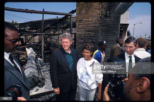 Presidential candidate Governor Bill Clinton stands with singer Dionne Warwick May 4 1992 in Los Angeles CA The southcentral area of Los Angeles was...