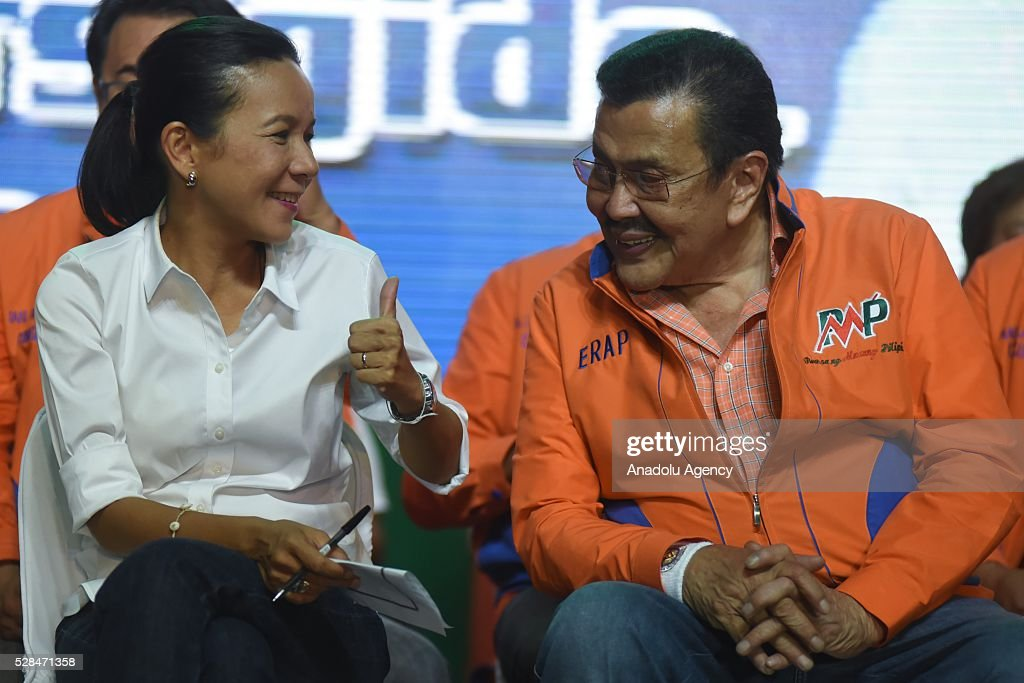 Presidential candidate Grace Poe chats with his godfather and former Philippine President Joseph Estrada during the latters meeting de avance in Tondo district, Manila on 05 May 2016. Despite facing corruption charges, an impeachment trial and thousands of anti-Estrada protesters during his presidency in 2001, Estrada won the hearts of the Filipinos again and won a mayoral seat in 2013. He is now running for the same post in the upcoming elections, and supports Poes run for the presidency.