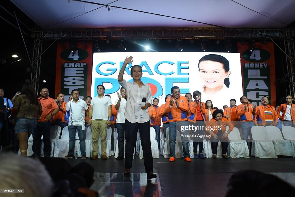Presidential candidate Grace Poe waves to the crowd as she attends the meeting de avance of his godfather and former Philippine President Joseph Estrada in Tondo district, Manila on 05 May 2016. Poe is the adoptive daughter of the late movie star Fernando Poe Jr, who is known to be best friends with Joseph Estrada.