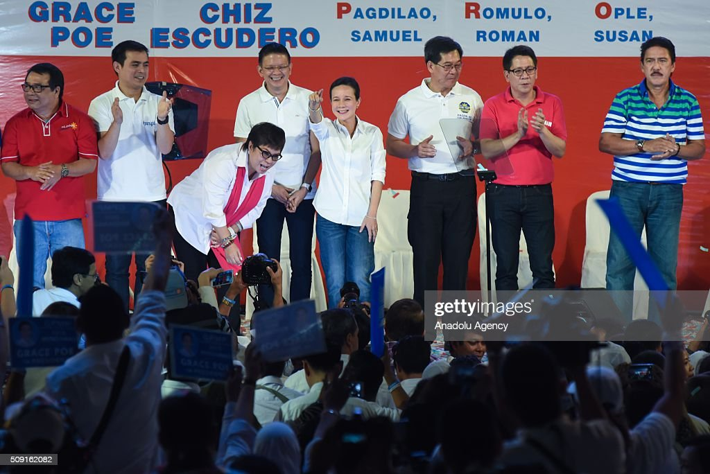 Presidential candidate Grace Poe-Llamanzares (center) poses with her senatorial candidates during their proclamation rally at the Plaza Miranda in Manila on 09 February 2016. Poe-Llamanzaress candidacy was surrounded by controversy regarding her eligibility because of her US citizenship.