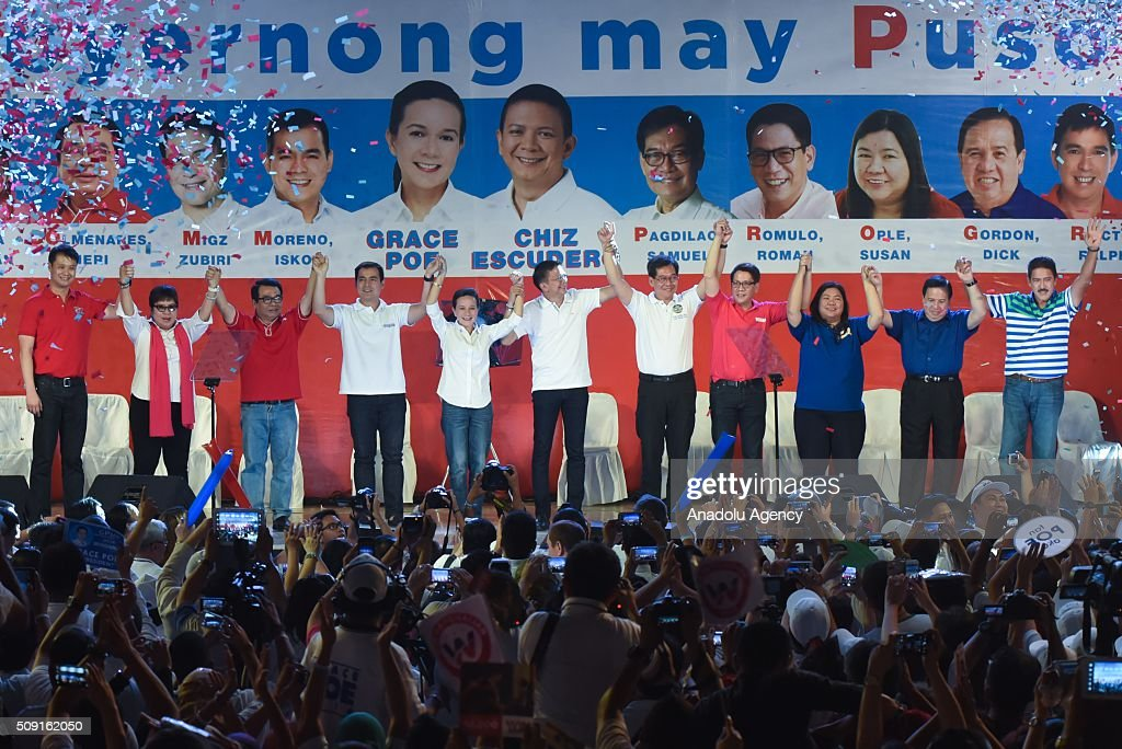 Presidential candidate Grace Poe-Llamanzares (5th from L) together with Vice Presidential candidate Chiz Escudero (6th from L) pose with their senatorial candidates during their proclamation rally at the Plaza Miranda in Manila on 09 February 2016.