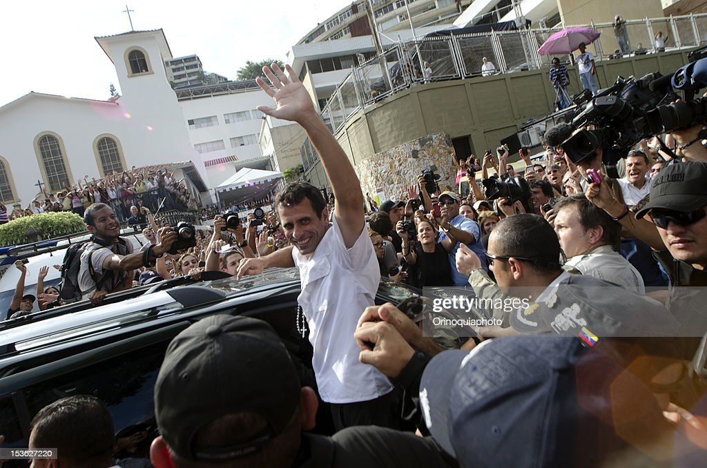 Presidential Candidate Henrique Capriles greets his supporters after voting on October 07, 2012 in Caracas, Venezuela.