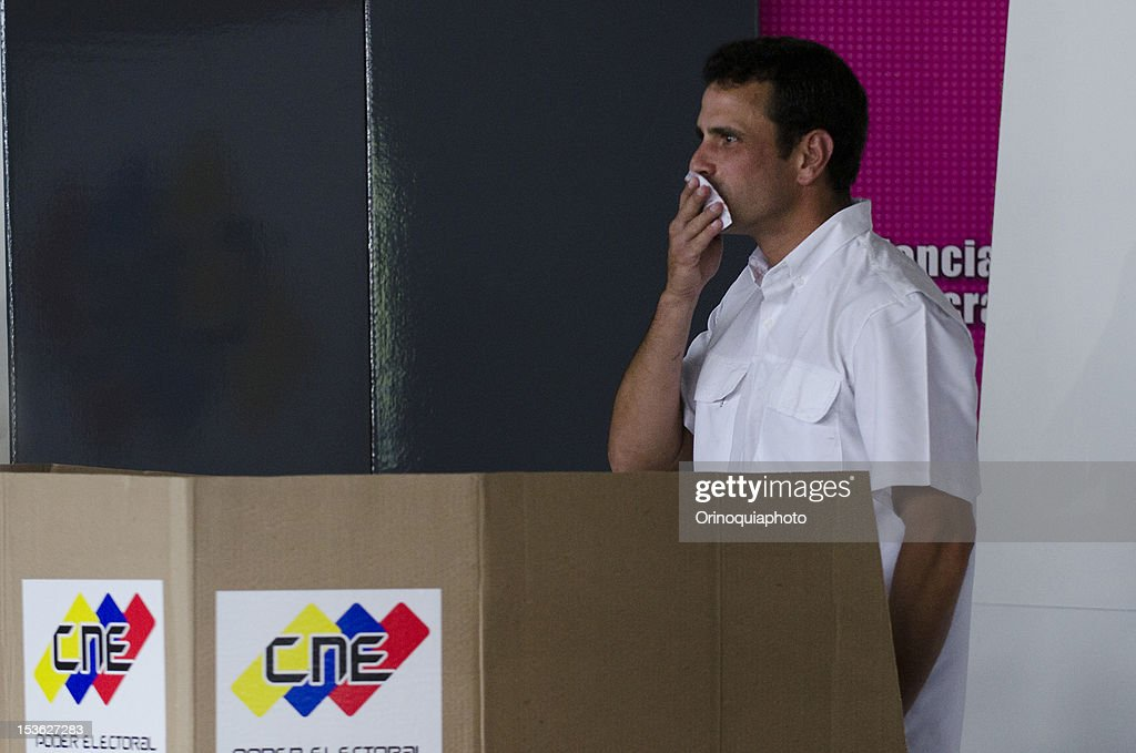 Presidential Candidate Henrique Capriles kisses his vote on October 07, 2012 in Caracas, Venezuela.