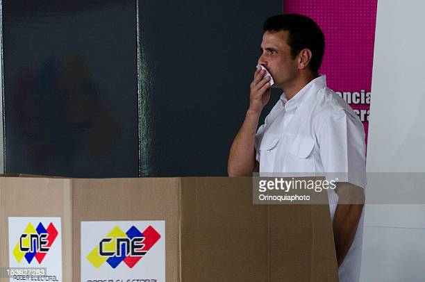 Presidential Candidate Henrique Capriles kisses his vote on October 07 2012 in Caracas Venezuela