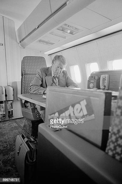 Presidential candidate Jimmy Carter at work aboard his campaign aircraft 'Peanut One' September 13 1976