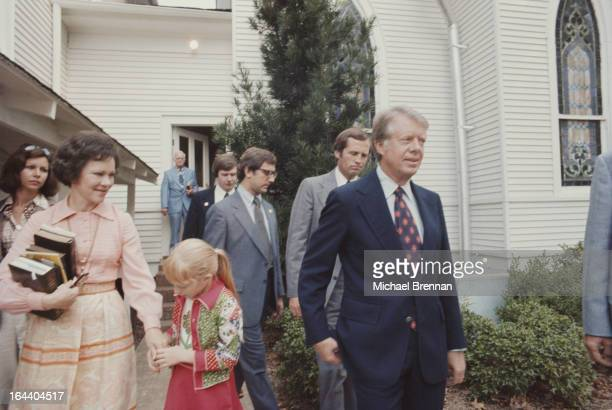 US Presidential candidate Jimmy Carter with his wife Rosalynn Carter and their daughter Amy at the Baptist church in his hometown of Plains Georgia...