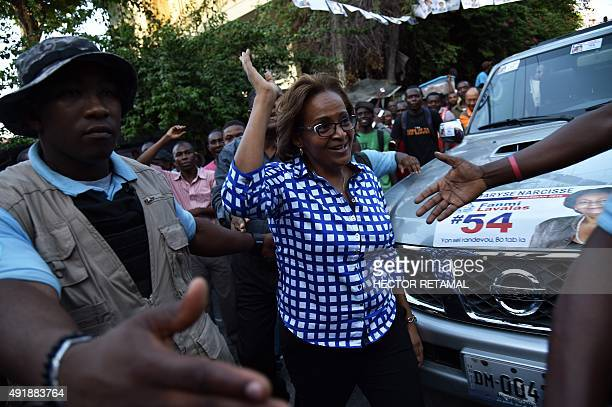 Presidential candidate Maryce Narcisse waves to her supporters from the Fanmi Lavalas Political Party during a party rallyin Petion Ville...