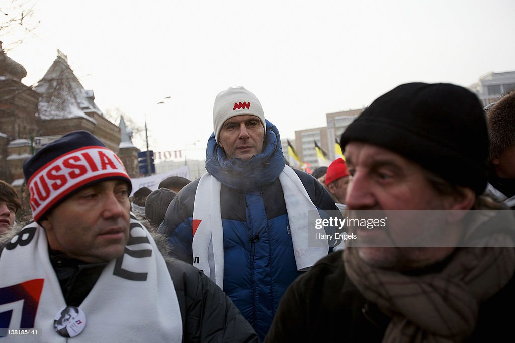 Presidential candidate Mikhail Prokhorov (C), who is running against Vladimir Putin in the March elections, makes his way to Bolotnaya Square with protesters on February 4, 2012 in Moscow, Russia. Demonstrators braved temperatures as low as -20 degrees celsius as they took to the streets exactly one month before the presidential elections in protest against Vladimir Putin's efforts to return to the Kremlin for an unprecedented third term as President.