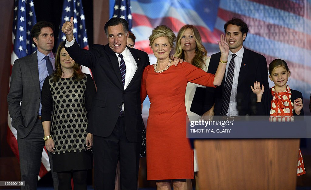 US Presidential candidate Mitt Romney and his wife Ann Romney wave to supporters as they are joined by their family on election night November 7, 2012 in Boston Massachusetts. Romney conceded the race to US President Barack Obama. Ann Romney is at left.