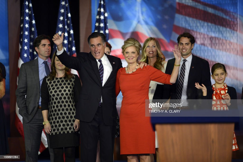 US Presidential candidate Mitt Romney and his wife Ann Romney wave to supporters as they are joined by their family on election night November 7, 2012 in Boston Massachusetts. Romney conceded the race to US President Barack Obama. Ann Romney is at left. AFP PHOTO/ TIMOTHY A. CLARY