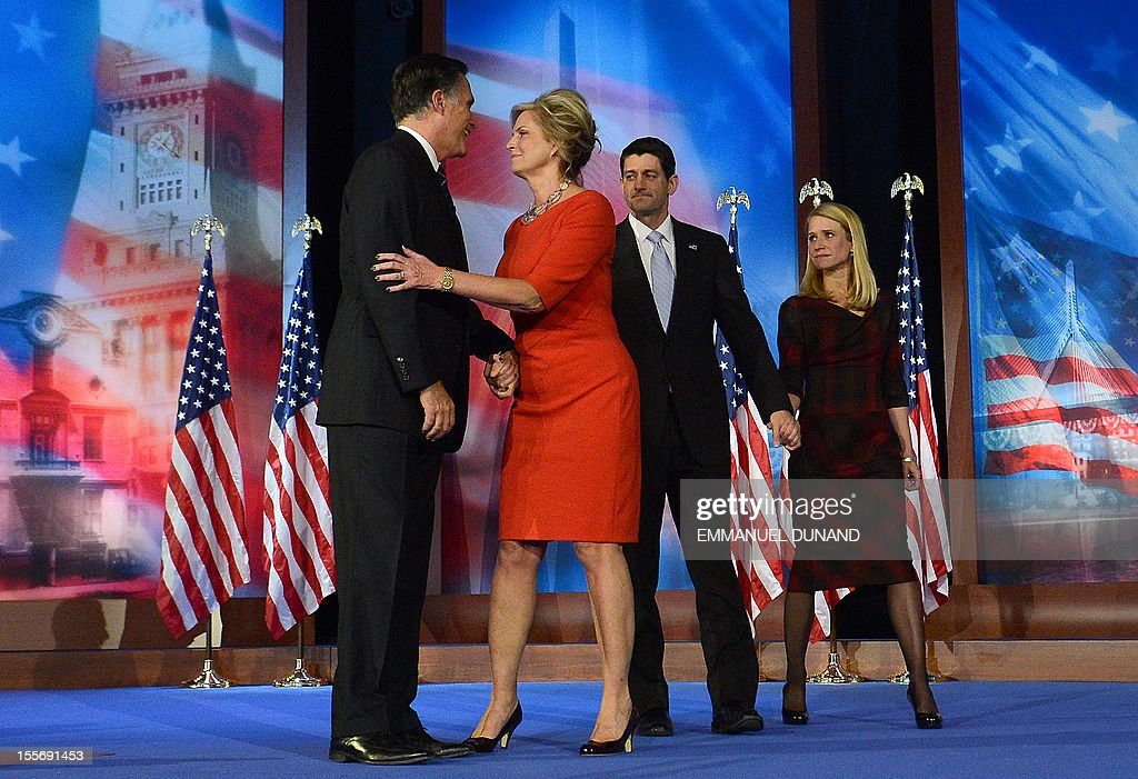 US Presidential candidate Mitt Romney and his wife Ann stand on stage with Paul Ryan and wife Janna after Romney conceded defeat to US President Barack Obama November 7, 2012 in Boston, Massachusetts.