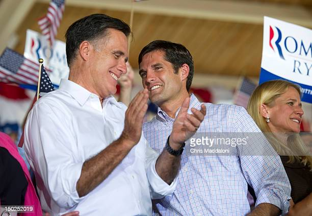 """GOP presidential candidate Mitt Romney speaks to his son Matt at a rally in Manassas during his """"Plan For A Stronger Middle Class' bus tour in..."""