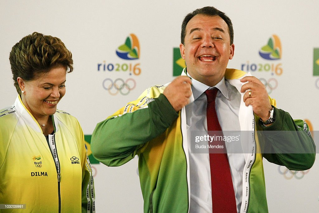 Presidential candidate of Brazil Dilma Rousseff (L) and governor of Rio Sergio Cabral wear the official uniform of Brazilian Olympic Committee during a visit as part of her campaign on August 2, 2010 in Rio de Janeiro, Brazil.