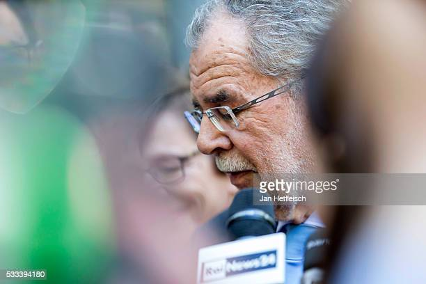 Presidential candidate of Green Party Alexander Van der Bellen makes a statement to the media after casting his ballot at a polling station during...