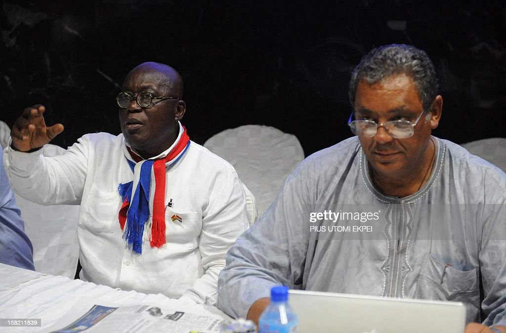 Presidential candidate of the opposition New Patriotic Party Nana AkufoAddo raises hand as chairman of the party Jake ObetsebiLamptey speaks on...
