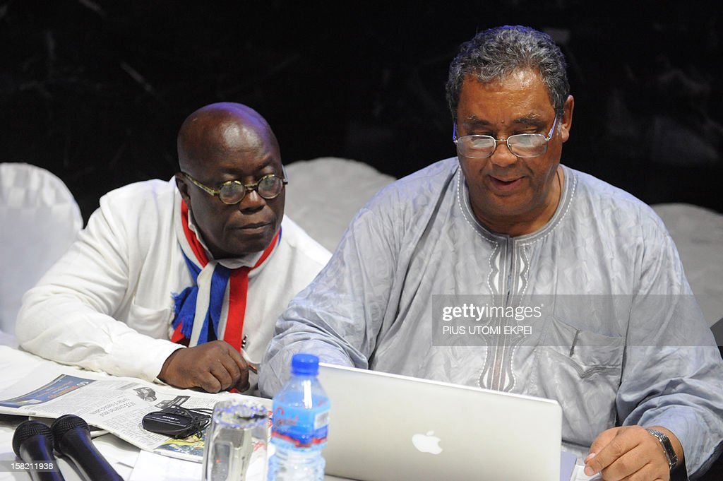 Presidential candidate of the opposition New Patriotic Party Nana Akufo-Addo (L) cross checks information on a laptop with chairman of the party Jake Obetsebi-Lamptey during a press point on planned legal action to challenging the recent presidential election results, in Accra on December 11, 2012. Ghana's main opposition candidate Nana Akufo-Addo on Tuesday refused to accept presidential election results giving victory to incumbent John Dramani Mahama and vowed to challenge them in court. Speaking at a rally of several hundred people in the capital, Akufo-Addo urged supporters to remain peaceful, but spoke out strongly against the results after his New Patriotic Party alleged a 'pattern of fraud' in the election. AFP PHOTO / PIUS UTOMI EKPEI