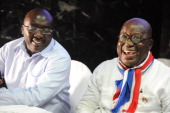 Presidential candidate of the opposition New Patriotic Party Nana AkufoAddo laughs beside Vicepresidential candidate Mahamudu Bawumia during a press...