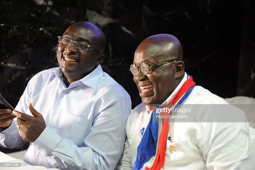 Presidential candidate of the opposition New Patriotic Party Nana Akufo-Addo (L) laughs beside Vice-presidential candidate Mahamudu Bawumia during a press point on planned legal action to challenging the recent presidential election results, in Accra on December 11, 2012. Ghana's main opposition candidate Nana Akufo-Addo on Tuesday refused to accept presidential election results giving victory to incumbent John Dramani Mahama and vowed to challenge them in court. Speaking at a rally of several hundred people in the capital, Akufo-Addo urged supporters to remain peaceful, but spoke out strongly against the results after his New Patriotic Party alleged a 'pattern of fraud' in the election. AFP PHOTO / PIUS UTOMI EKPEI