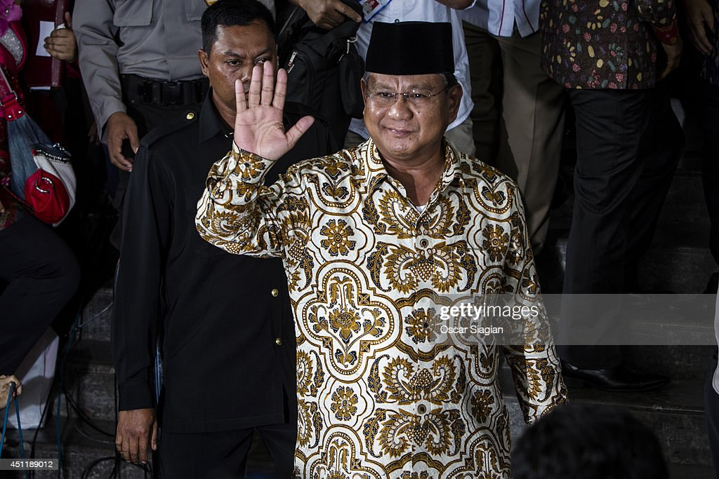 Presidential candidate <a gi-track='captionPersonalityLinkClicked' href=/galleries/search?phrase=Prabowo+Subianto&family=editorial&specificpeople=3051840 ng-click='$event.stopPropagation()'>Prabowo Subianto</a> waves after attending the Corruption Eradication Commission invitation on June 25, 2014 in Jakarta, Indonesia. The Corruption Eradication Commission (KPK) has invited both pairs of presidential and vice presidential candidates to clarify the wealth reports that they have submitted to the antigraft body..The findings of the Commission may have a large impact on the campaign leading up to the Jakarta Elections on July 9th
