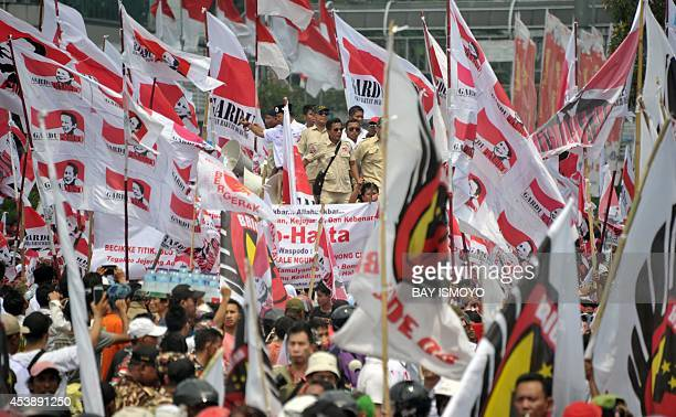 Presidential candidate Prabowo's supporters march to the constitutional court in Jakarta on August 21 where the court will announce its decision on...