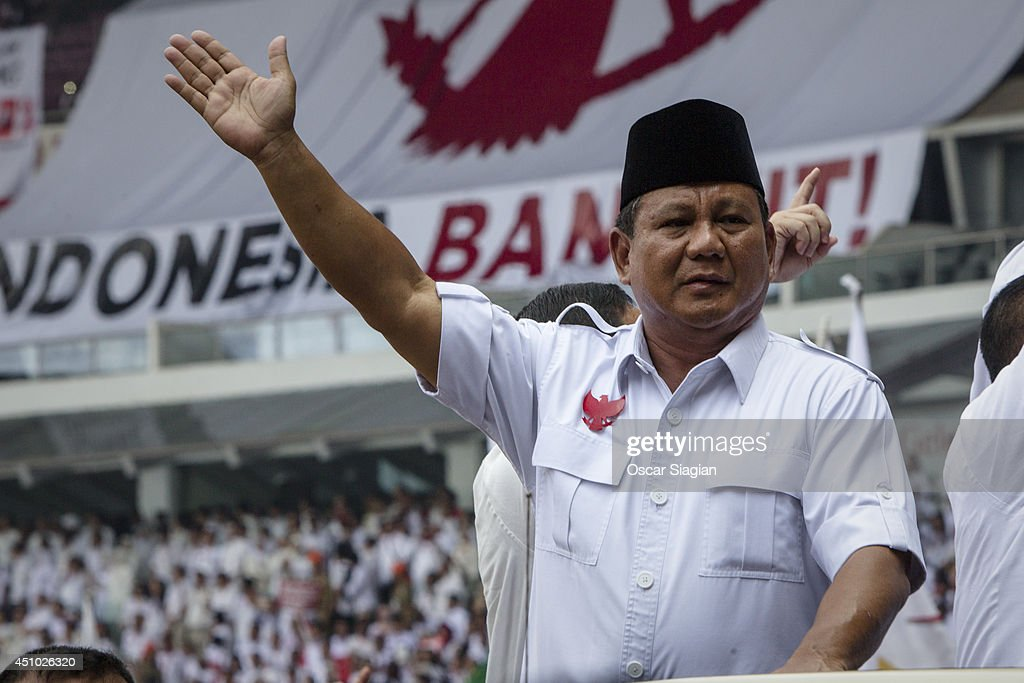 Presidential candidate retired general <a gi-track='captionPersonalityLinkClicked' href=/galleries/search?phrase=Prabowo+Subianto&family=editorial&specificpeople=3051840 ng-click='$event.stopPropagation()'>Prabowo Subianto</a>, the leader of the Gerindra party, greets supporters during an election rally at Gelora Bung Karno stadium on June 22, 2014 in Jakarta, Indonesia. A leaked military dismissal letter this week is again raising questions about Prabowo's involvement in human rights violations in 1998 when he was the head of Indonesia's special forces. It has not been confimed that the letter is authentic. Indonesians will elect a new president on July 9, 2014.