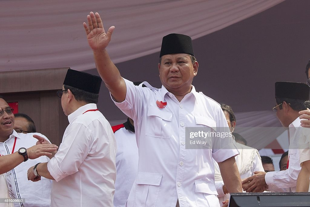 Presidential candidate retired general <a gi-track='captionPersonalityLinkClicked' href=/galleries/search?phrase=Prabowo+Subianto&family=editorial&specificpeople=3051840 ng-click='$event.stopPropagation()'>Prabowo Subianto</a>, the leader of the Gerindra party, waves to supporters during an election rally at Gelora Bung Karno stadium on June 22, 2014 in Jakarta, Indonesia. A leaked military dismissal letter this week is again raising questions about Prabowo's involvement in human rights violations in 1998 when he was the head of Indonesia's special forces. It has not been confimed that the letter is authentic. Indonesians will elect a new president on July 9, 2014.