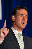 GOP Presidential candidate Rick Santorum speaks to a crowd at the Regan / Lincoln Day forum sponsored by the Faith Freedom Coalition in Pewaukee...
