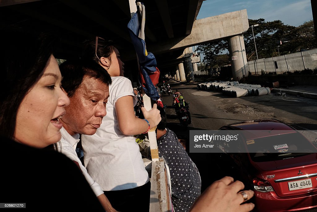Presidential candidate <a gi-track='captionPersonalityLinkClicked' href=/galleries/search?phrase=Rodrigo+Duterte&family=editorial&specificpeople=15240619 ng-click='$event.stopPropagation()'>Rodrigo Duterte</a> campaigns among supporters on May 1, 2016 in the Philippines. Duterte, the tough-talking mayor of Davao in Mindanao has been the surprise pre-election poll favorite, pulling away from his rivals despite controversial speeches and little national government experience. Opinion polls have shown Mr. Duterte has maintained his lead with 33 percent support, with Senator Grace receiving 22 percent. The Philippine presidential elections will be held on May 9, with five candidates vying for the top post.