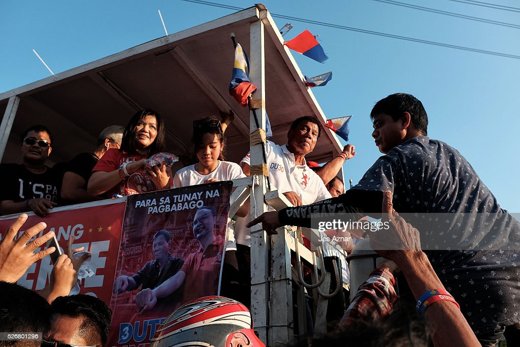 Presidential candidate Rodrigo Duterte (in white) campaigns on May 1, 2016 in Manila, Philippines. Duterte, the tough-talking mayor of Davao in Mindanao has been the surprise pre-election poll favorite, pulling away from his rivals despite controversial speeches and little national government experience. Opinion polls have shown Mr. Duterte has maintained his lead with 33 percent support, with Senator Grace receiving 22 percent. The Philippine presidential elections will be held on May 9, with five candidates vying for the top post.