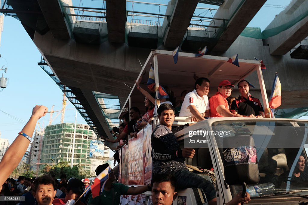 Presidential candidate <a gi-track='captionPersonalityLinkClicked' href=/galleries/search?phrase=Rodrigo+Duterte&family=editorial&specificpeople=15240619 ng-click='$event.stopPropagation()'>Rodrigo Duterte</a> (in white) campaigns on May 1, 2016 in Manila, Philippines. Duterte, the tough-talking mayor of Davao in Mindanao has been the surprise pre-election poll favorite, pulling away from his rivals despite controversial speeches and little national government experience. Opinion polls have shown Mr. Duterte has maintained his lead with 33 percent support, with Senator Grace receiving 22 percent. The Philippine presidential elections will be held on May 9, with five candidates vying for the top post.