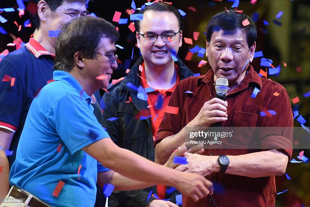 Presidential candidate Rodrigo Duterte (R) greets supporters during their proclamation rally in Manila on February 9, 2016. Duterte is well known for being the crime fighting mayor of Davao City, southern Philippines.
