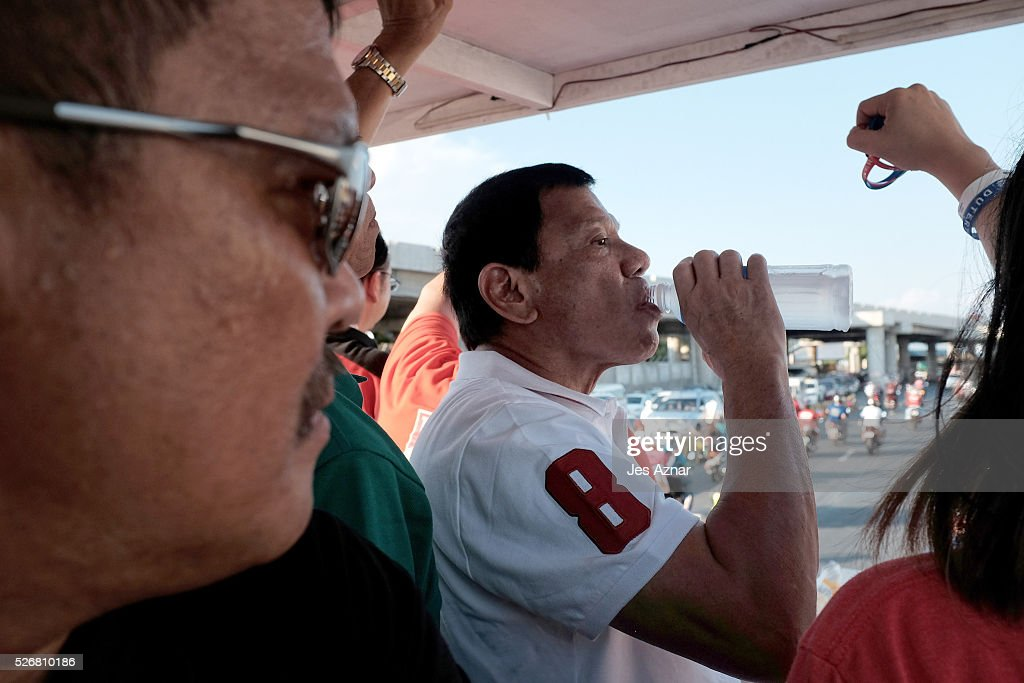 Presidential candidate <a gi-track='captionPersonalityLinkClicked' href=/galleries/search?phrase=Rodrigo+Duterte&family=editorial&specificpeople=15240619 ng-click='$event.stopPropagation()'>Rodrigo Duterte</a> takes a water break while campaigning on May 1, 2016 in Manila, Philippines. Duterte, the tough-talking mayor of Davao in Mindanao has been the surprise pre-election poll favorite, pulling away from his rivals despite controversial speeches and little national government experience. Opinion polls have shown Mr. Duterte has maintained his lead with 33 percent support, with Senator Grace receiving 22 percent. The Philippine presidential elections will be held on May 9, with five candidates vying for the top post.