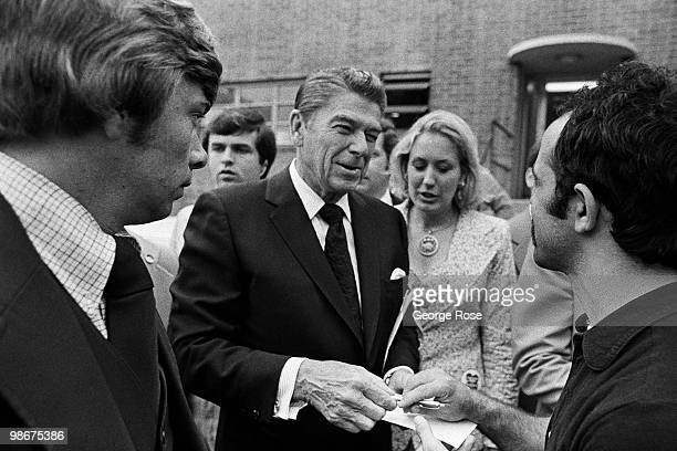 Presidential candidate Ronald Reagan signs autographs after a speech as seen in this 1976 Los Angeles California photo leading up to the Republican...