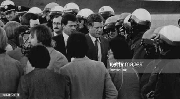 Presidential Candidate Sen Edward Kennedy Visits ***** Kennedy surrounded by Denver police and with a determinedlooking Secret Service agent at his...