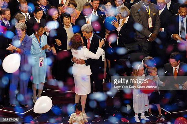 Presidential candidate Sen John Kerry dances with wife Teresa Heinz Kerry as red white and blue confetti and balloons fall after his speech on the...