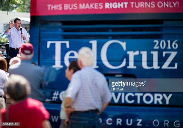 Presidential candidate Sen Ted Cruz speaks to supporters from the bed of a pick up truck during the Cruz campaign bus tour rally in a field behind...