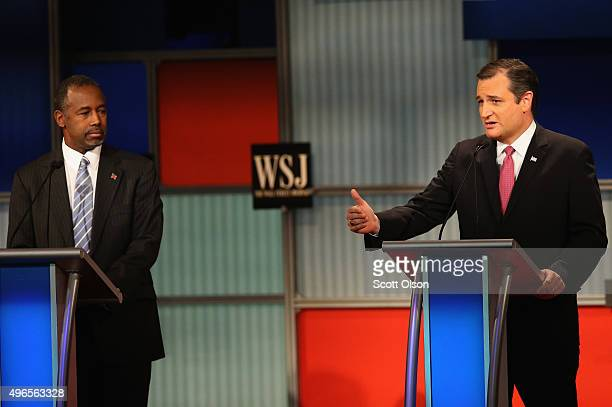 Presidential candidate Sen Ted Cruz speaks while Ben Carson looks on the during the Republican Presidential Debate sponsored by Fox Business and the...