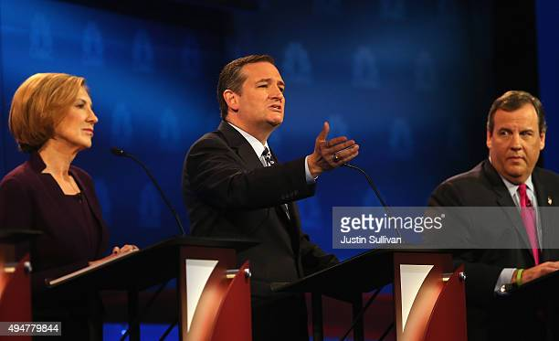 Presidential candidate Sen Ted Cruz speaks while New Jersey Gov Chris Christie and Carly Fiorina look on during the CNBC Republican Presidential...