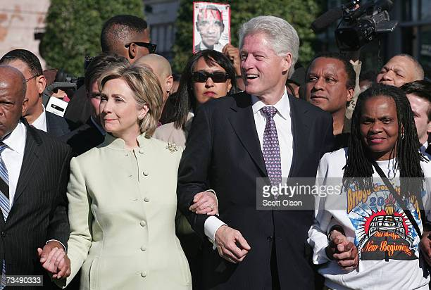 Presidential candidate Senator Hillary Clinton and her husband former President Bill Clinton march with a crowd to the Edmund Pettus Bridge to...