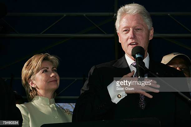 Presidential candidate Senator Hillary Clinton watches as her husband former President Bill Clinton makes a speech after being inducted into the...