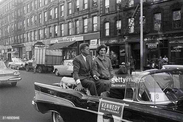 Presidential candidate Senator John F Kennedy rides with Jackie Kennedy in a car along 116th Street in New York Kennedy campaigned here for the...
