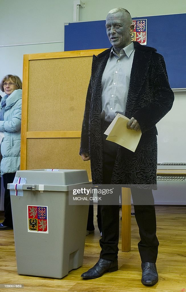 Presidential candidate Vladimir Franz poses next to a ballot box at a polling station in Prague on January 11, 2013. Czech polling stations were opened on January 11 afternoon in local mid-time for the first round of the first Czech direct presidential election in history.