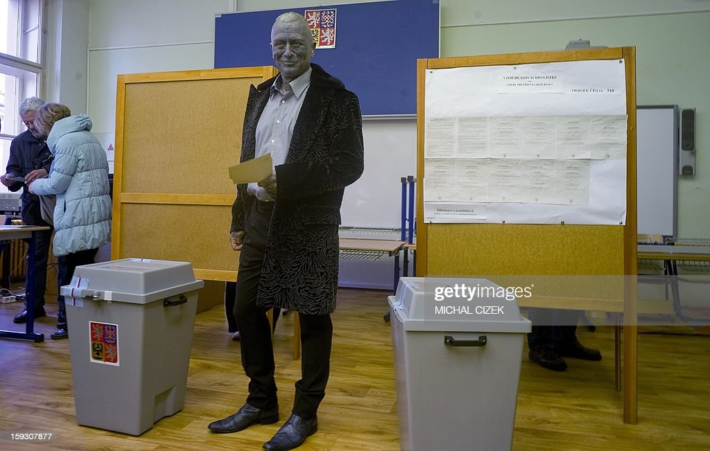 Presidential candidate Vladimir Franz poses poses with his ballot at a polling station in Prague on January 11, 2013. Czech polling stations were opened on January 11 afternoon in local mid-time for the first round of the first Czech direct presidential election in history.