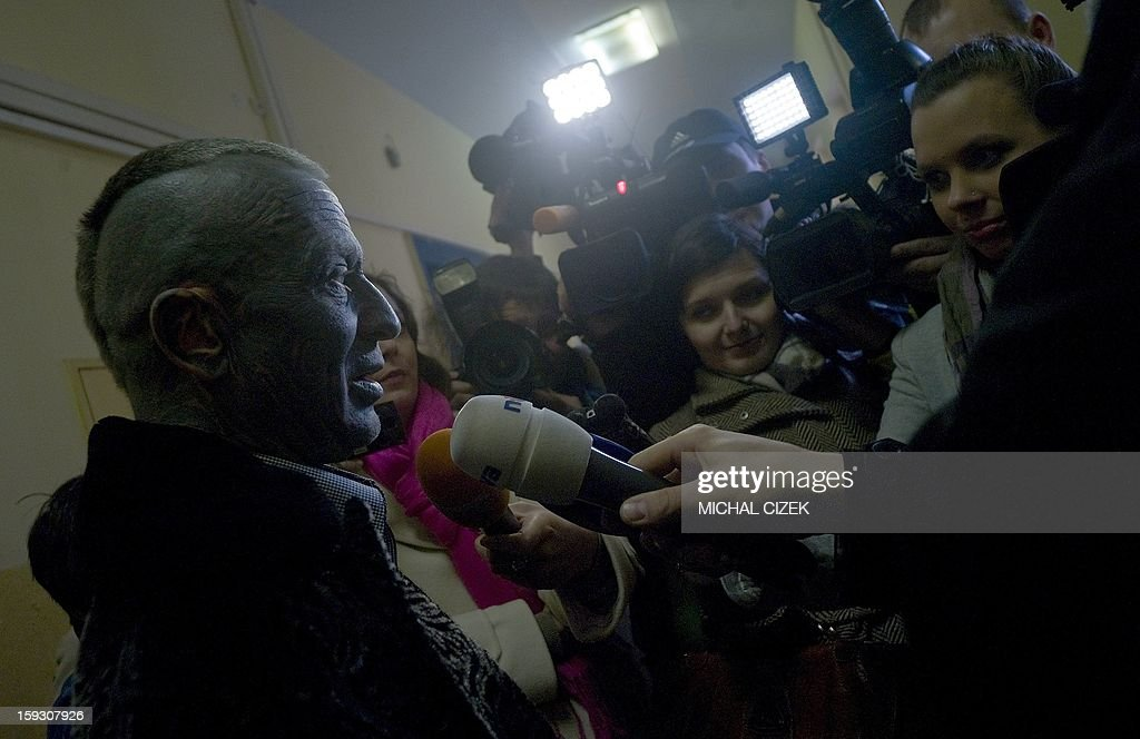 Presidential candidate Vladimir Franz talks to journalists after casting his vote at a polling station in Prague on January 11, 2013. Czech polling stations were opened on January 11 afternoon in local mid-time for the first round of the first Czech direct presidential election in history.