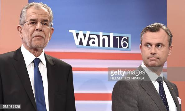 Presidential candidates Alexander Van der Bellen of Austrian Greens and Norbert Hofer of Austrian Freedom party attend a television discussion after...