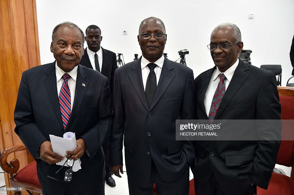 Presidential candidates Dejean Belezaire(L), Senator Jocelerme Privert(C) and Edgard Leblanc(R) stand together listens as Haitian lawmakers prepare to elect an interim president February 13, 2016 in Port-au-Prince. Haitian lawmakers were set to elect an interim president to fill the power vacuum following the departure of Michel Martelly, after a vote to choose his replacement was postponed over fears of violence. / AFP / HECTOR RETAMAL