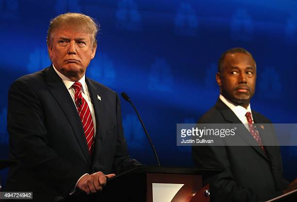 Presidential candidates Donald Trump and Ben Carson look on during the CNBC Republican Presidential Debate at University of Colorados Coors Events...