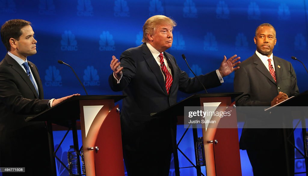 Presidential candidates Donald Trump (L) speaks while Ben Carson (R) and Sen. Marco Rubio (R-FL) look on during the CNBC Republican Presidential Debate at University of Colorados Coors Events Center October 28, 2015 in Boulder, Colorado. Fourteen Republican presidential candidates are participating in the third set of Republican presidential debates.